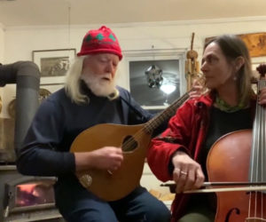"The duo Buxbaum and Dunn performs the original song ""Eat the Rich"" during Damariscotta Open Mic's Peaceful New Beginnings concert. Brian Dunn plays an octave mandolin he made himself and Laura Buxbaum plays the cello. (Screenshot by Evan Houk)"