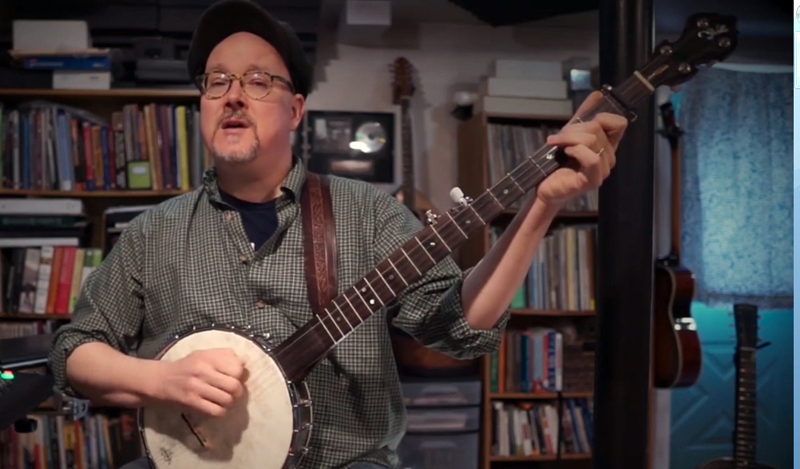 "Maine native and nationally recognized recording artist Jud Caswell performs his tune ""That's the Way We Climb"" from his home studio in Brunswick during Damariscotta Open Mic's Peaceful New Beginnings show. (Screenshot by Evan Houk)"