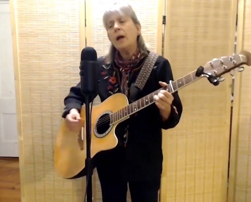 "Sylvia Tavares closes out Damariscotta Open Mic's Peaceful New Beginnings show with a down-home country version of folk singer-songwriter Kate Wolf's ""Give Yourself to Love."" (Screenshot by Evan Houk)"