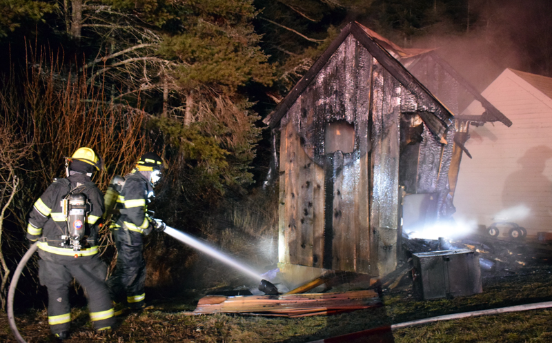 Firefighters mop up after a fire in a sauna behind a home at 153 West Old County Road in Newcastle on Thursday, Jan. 21. A quick response minimized heat damage to the house and a shed. (Evan Houk photo)