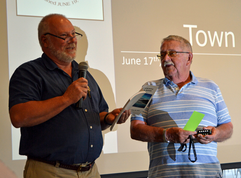 Newcastle Board of Selectmen Chair Brian Foote (left) dedicates the annual town report to Allan Ray at annual town meeting on June 17, 2019. Foote plans to resign from the board. (Evan Houk photo, LCN file)
