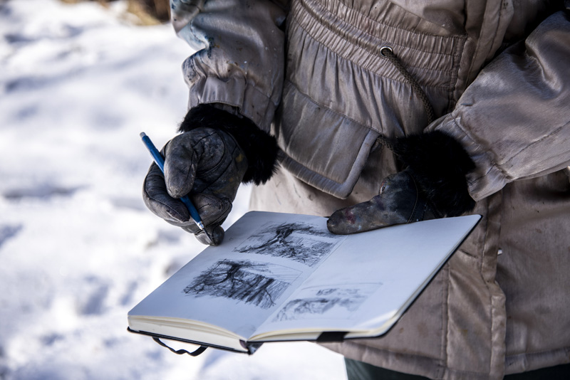 Roberta Goschke shares her sketchbook in Waldoboro on Sunday, Jan. 10. Goschke often starts her plein-air paintings as small sketches. (Bisi Cameron Yee photo)
