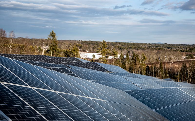 Solar panels work with the topography of the site at the SunRaise solar garden in Waldoboro on Dec. 22. Metal rods tipped with screws are driven 4 feet into the granite ledge to stabilize the large panels. (Bisi Cameron Yee photo)