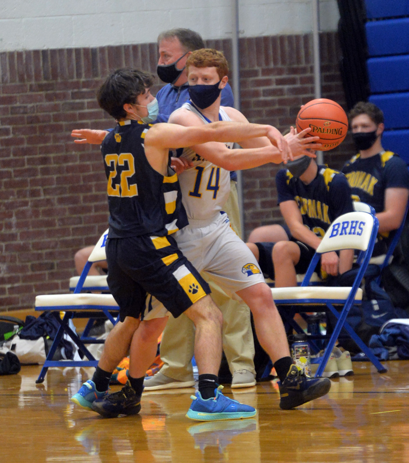 Kaleb Ames looks for an open Boothbay teammate as Aiden Starr defends for Medomak. (Paula Roberts photo)