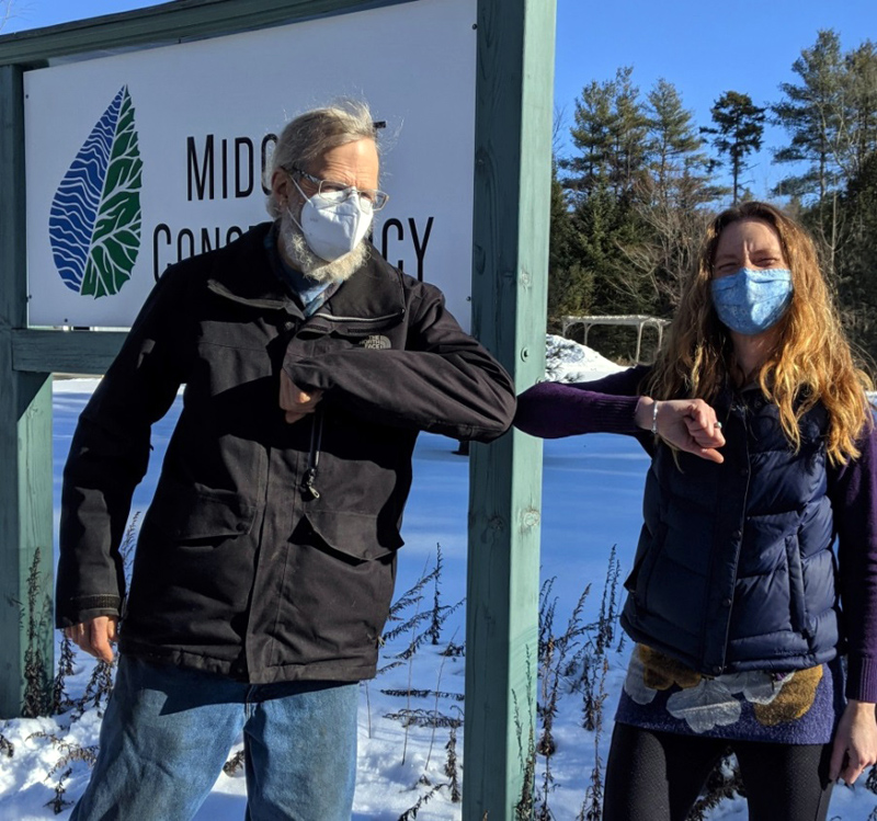 Landowner, Jim Doble, and Land Protection Specialist, Anna Fiedler, formalize Doble's donated Conservation Easement on land in Waldoboro.