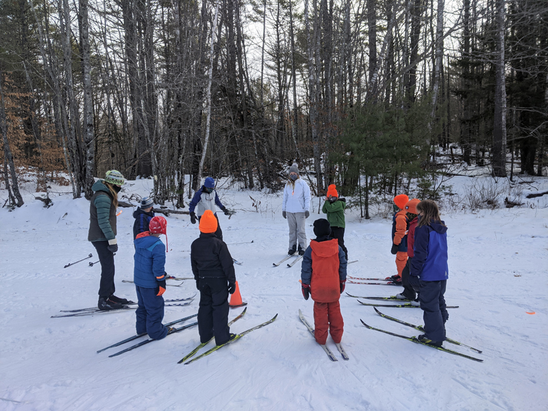 Youth cross-country ski clinic circles up for their ski lesson at HVNC. (Photo courtesy Anna Fiedler)