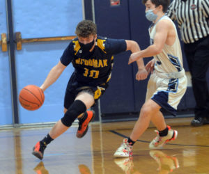 Patrick McKenney brings the ball up the court for Medomak. (Paula Roberts photo)