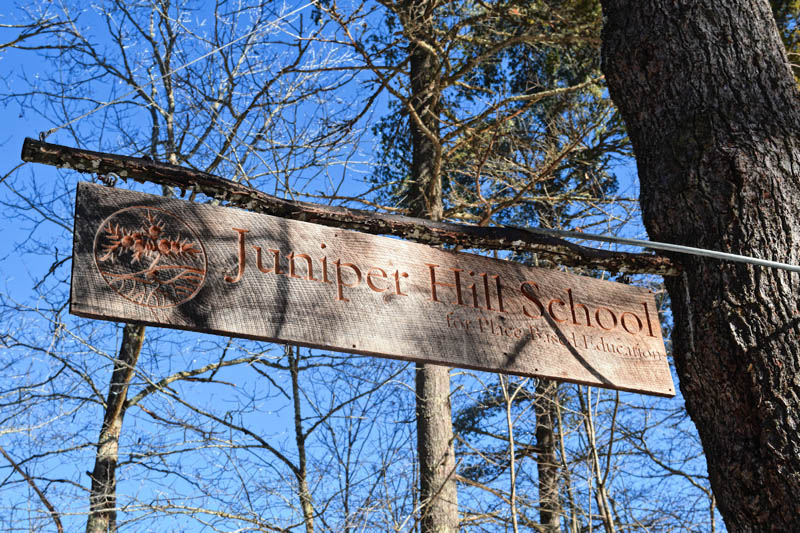 The sign at the entrance to the Juniper Hill School for Place-based Education, at 180 Golden Ridge Road in Alna. (Hailey Bryant photo)