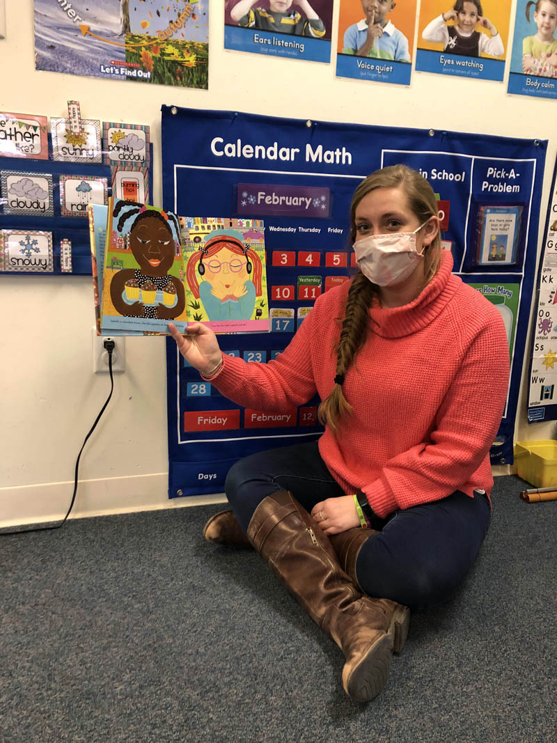 Sally Monroe holds up a picture book in her prekindergarten classroom at Edgecomb Eddy School. (Photo courtesy Sally Monroe)