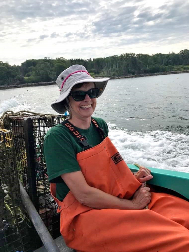 Dr. Kristin Kentopp fishes for lobster off the coast of Bristol. The Togus physician and former professional ballerina holds a recreational lobster license. (Photo courtesy Kristin Kentopp)
