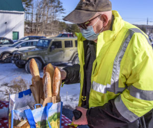 William Nicholson stocks up on baguettes in Jefferson on Friday, Jan. 29. (Bisi Cameron Yee photo)