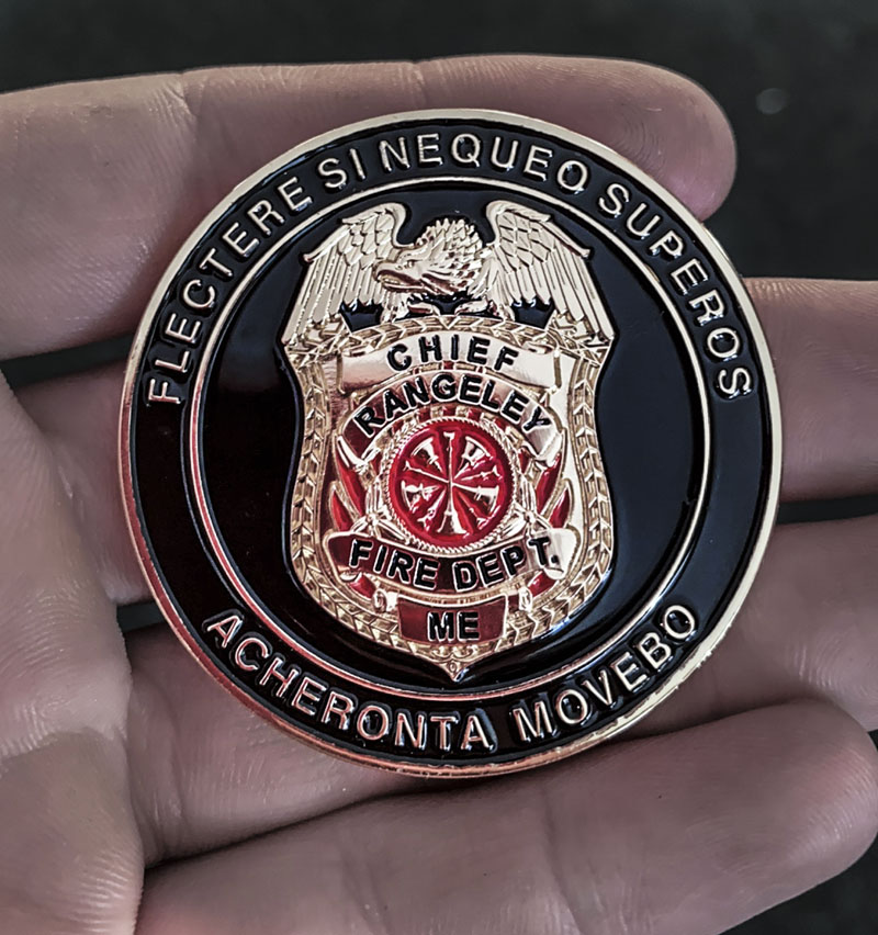 "The ""Chief's Coin"" given to Jefferson volunteer firefighter and first responder Oakley Oliver by Rangeley's fire and rescue chief in recognition of Oliver's assistance to an injured snowmobiler on Feb. 14. (Photo courtesy Jen Oliver)"