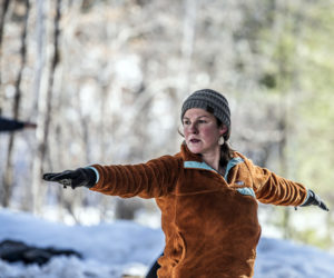 """Alicia Hunter strikes a """"Warrior 2"""" pose during a snowshoe yoga session at Hidden Valley Nature Center in Jefferson on Sunday, Feb. 21. Hunter said the class was """"perfectly paced."""" (Bisi Cameron Yee photo)"""
