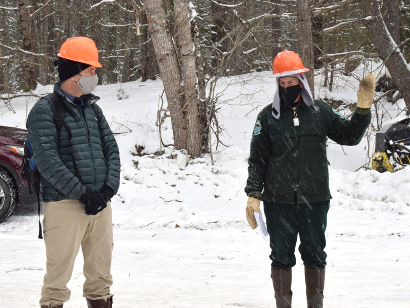 From left: Coastal Rivers Conservation Trust Executive Director Steven Hufnagel looks on as Stephen Richardson, senior forest engineer with the Maine Bureau of Parks and Lands, discusses the ongoing timber harvest at Dodge Point Public Reserved Land in Newcastle during a tour Tuesday, Feb. 10. (Evan Houk photo)