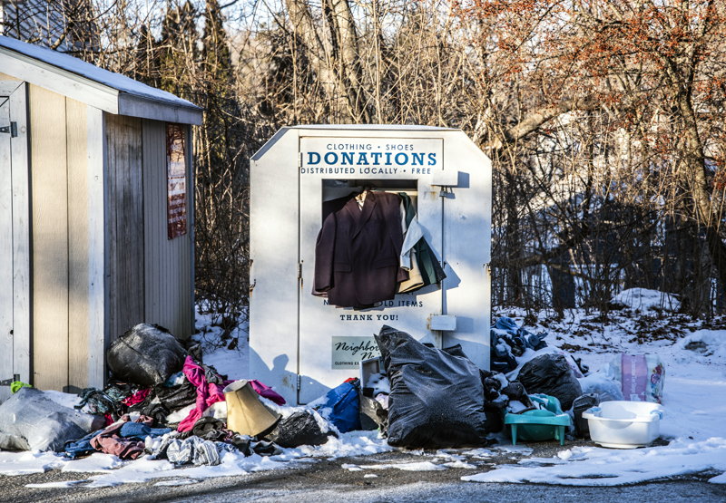 A clothing donation bin overflows in Waldoboro on Monday, Feb. 1. Residents have complained about the state of the bin, but the Waldoboro Free Clothing Closet suspended operations in March and posted signs to that effect. (Bisi Cameron Yee photo)