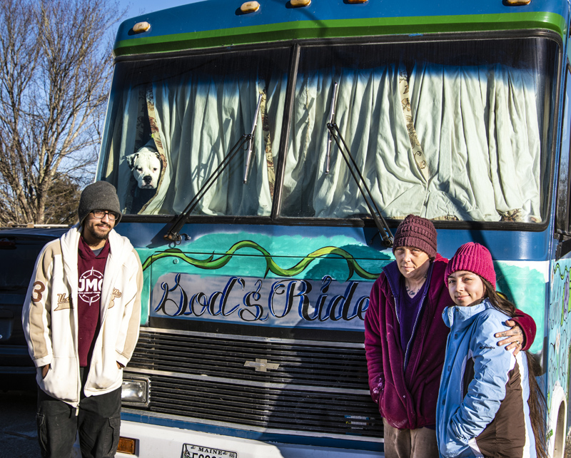 From left: Jacob, Jennifer, and Marijane Guerrero stand in front of their bus in Waldoboro on Jan. 23. The Guerreros plan to continue their traveling ministry after the loss of their husband and father, Joe Guerrero. (Bisi Cameron Yee photo)