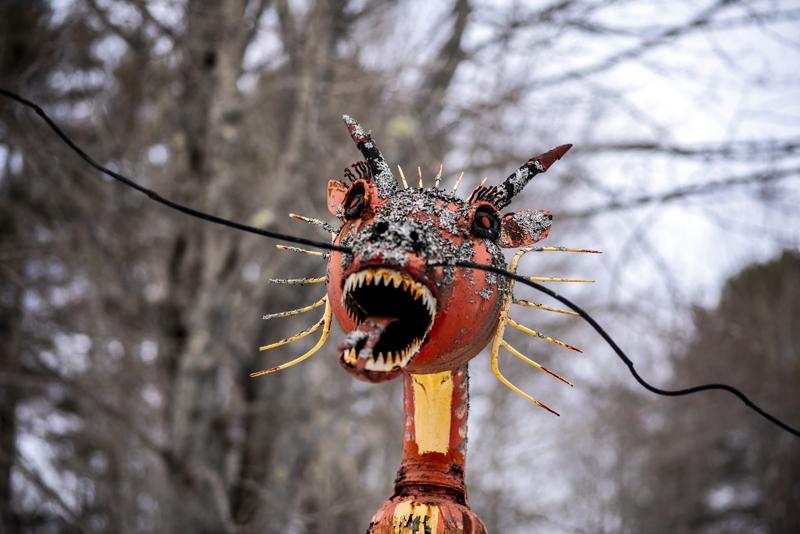 A metal dragon greets visitors to Nate Nicholls' recycled art garden in Waldoboro on Feb. 5. (Bisi Cameron Yee photo)