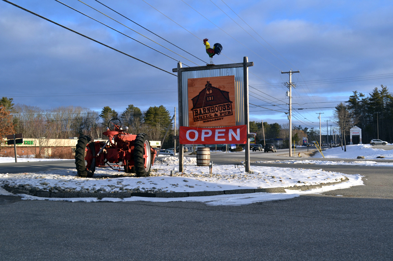 An open sign welcomes customers to the Barnhouse Grill & Pub in Wiscasset after nearly a year of preparation. (Charlotte Boynton photo)