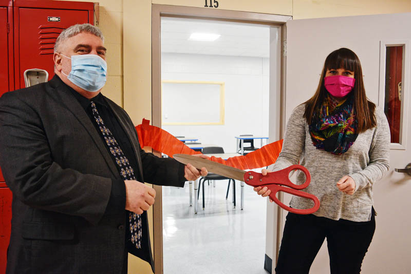 Wiscasset Middle High School Principal Charles Lomonte and health teacher Elizabeth Hemdal participate in a ribbon-cutting ceremony for the school's new classroom Monday, Feb. 22. (Hailey Bryant photo)