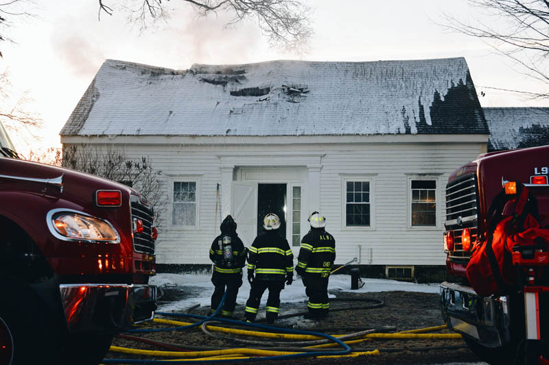 Firefighters spray foam to extinguish a fire at 1817 Alna Road in Alna early Wednesday, March 10. (Hailey Bryant photo)