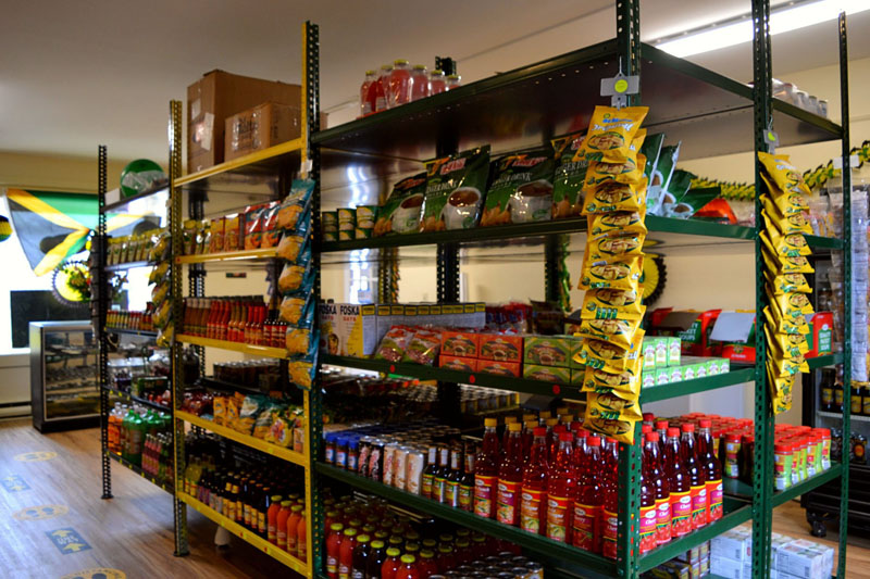Authentic Jamaican dry goods, seasonings, canned goods, sauces, and soft drinks line the shelves of J & J Jamaican Grocery and Gift Shop in Damariscotta. (Nettie Hoagland photo)