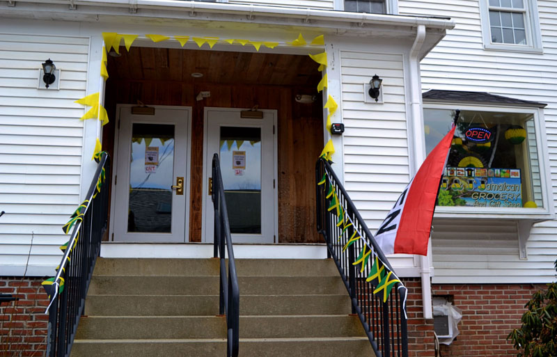 Jamaican flags line the steps up to J & J Jamaican Grocery and Gift Shop at 88 Main St. in Damariscotta. The entrance is on Courtyard Street, between the new and old locations of Best Thai. (Nettie Hoagland photo)