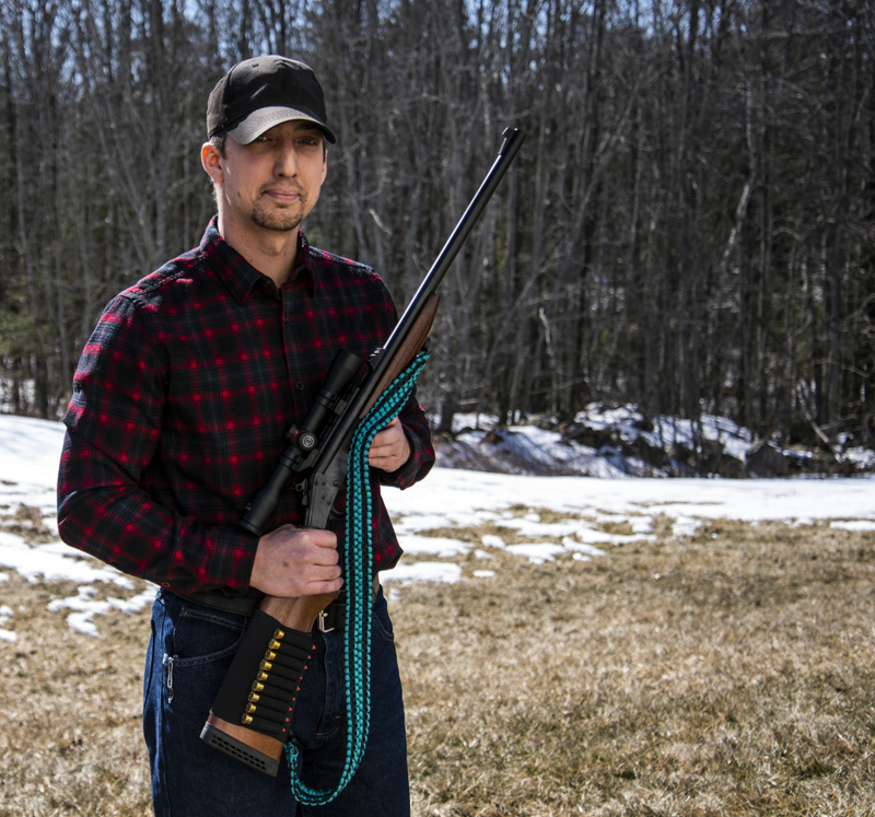 Tyler Richards demonstrates a rifle sling he crafted from paracord in Damariscotta on Monday, March 8. The sling uses over 100 feet of paracord and can be unbraided for use in a survival situation. (Bisi Cameron Yee photo)