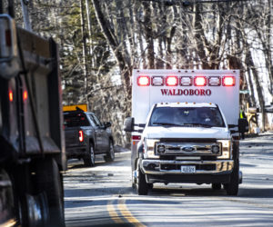A Waldoboro ambulance leaves the scene of a motor-vehicle crash in Jefferson on Monday, March 8. (Bisi Cameron Yee photo)