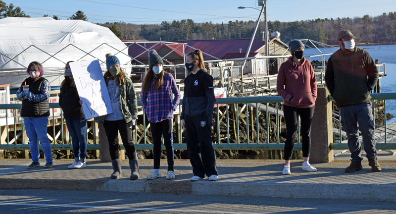 Demonstrators gather on the Damariscotta-Newcastle bridge to voice support for a return to full-time, in-person instruction at Lincoln Academy on Saturday, March 13. (Evan Houk photo)