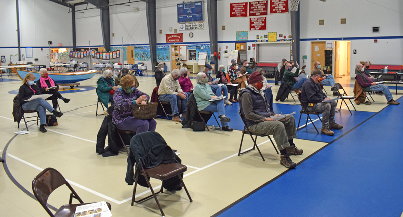 About 35 South Bristol residents attend annual town meeting in the South Bristol School gym on Tuesday, March 9. The meeting was fairly typical, despite the addition of masks and physical distancing. (Evan Houk photo)