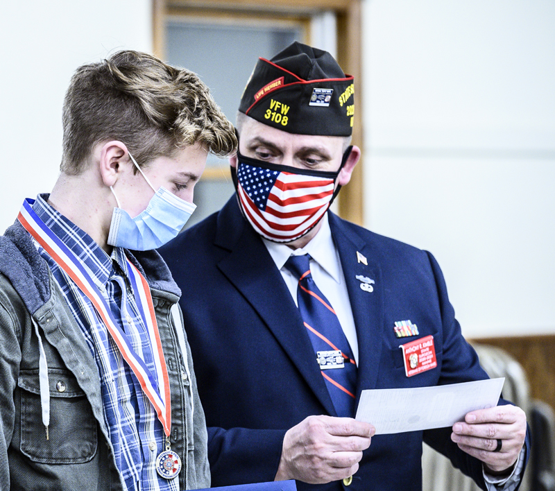 E.J. Hunt (left) receives a $500 check from Patriot's Pen Chair Anthony Kimble at the Veterans of Foreign Wars post in Waldoboro on Thursday, March 11. (Bisi Cameron Yee photo)