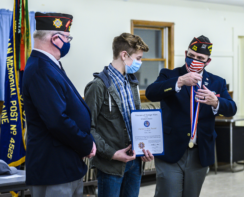 """E.J. Hunt (center) receives a medal from Veterans of Foreign Wars State Cmdr. Michael """"Keith"""" Davis (left) and Patriot's Pen Chair Anthony Kimble at the VFW post in Waldoboro on Thursday, March 11. (Bisi Cameron Yee photo)"""