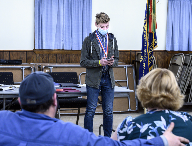 E.J. Hunt reads his prize-winning essay while his parents watch from the audience at the Veterans of Foreign Wars post in Waldoboro on Thursday, March 11. (Bisi Cameron Yee photo)