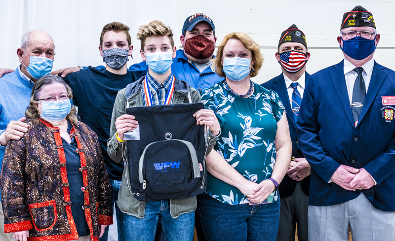 E.J. Hunt (fourth from left) poses with his family and Veterans of Foreign Wars representatives after receiving an award for his essay on patriotism at the VFW post in Waldoboro on Thursday, March 11. (Bisi Cameron Yee photo)