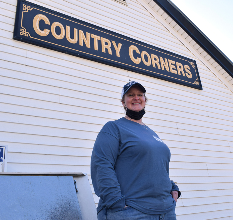 Erin King, owner of Country Corners Grocery, stands outside the Coopers Mills convenience store on Tuesday, March 16. (Evan Houk photo)
