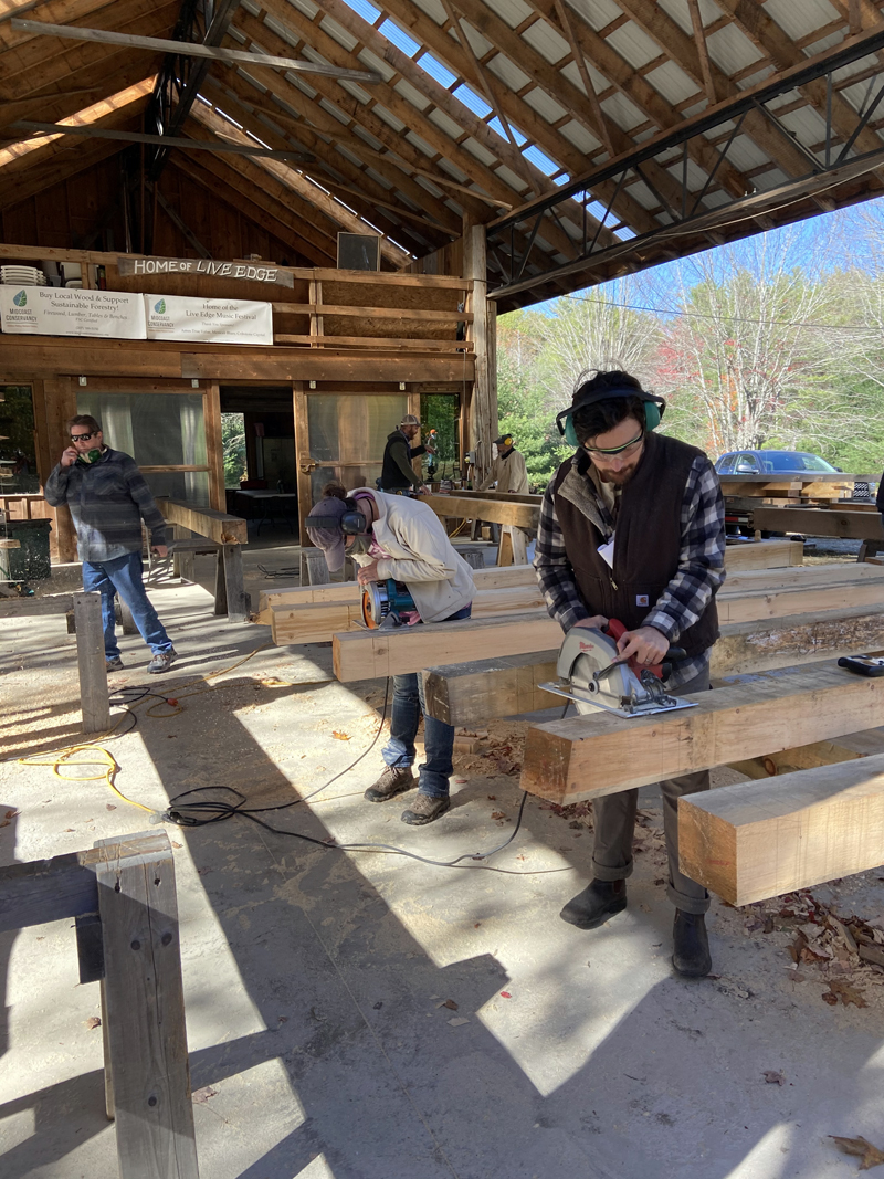 Beams lined up at a timber frame course.