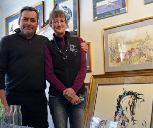 Todd and Sarah Richards stand in the new Sarah Richards Gallery in Damariscotta on Saturday, April 3. On the right is a floral watercolor by Sarah's late mother, Lyn Snow, above one of Sarah's horse watercolors. (Evan Houk photo)