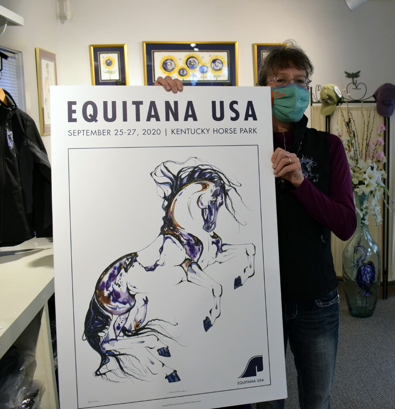 Sarah Richards displays the poster she designed for Equitana USA, a horse show that was set to take place in Ketucky last September. A poster is included with each purchase at Richards' new gallery in Damariscotta. (Evan Houk photo)
