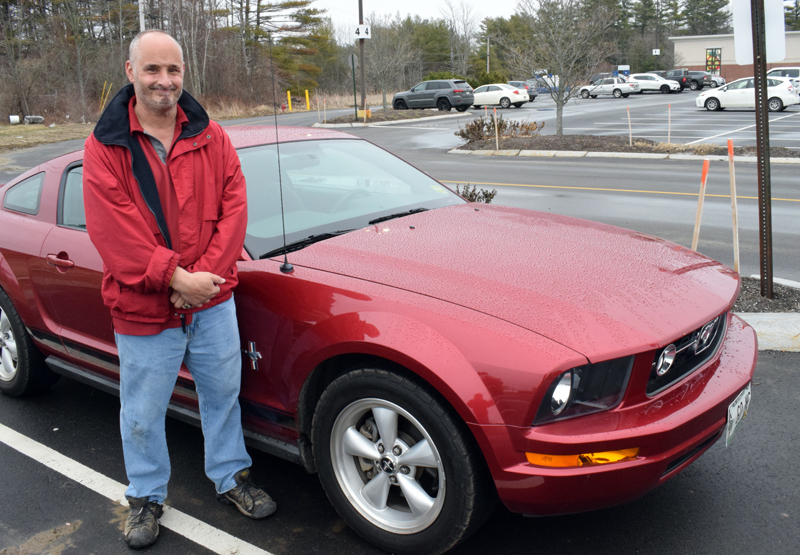 """Kyle LeBeau stands beside his beloved """"Mustang Sally"""" at his workplace, Hannaford Supermarket in Damariscotta, March 25. (Evan Houk photo)"""