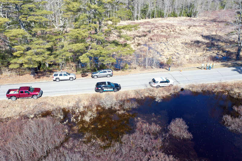 Authorities gather around a swamp off Back Meadow Road in Damariscotta during a search operation Saturday, April 3. (Photo courtesy HS Drone Works, Newcastle)