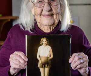 Fran Williamson, 103, poses for a picture with her younger self on Saturday, April 10. Williamson was the captain of the girl's basketball team at Crosby High School in Belfast. (Bisi Cameron Yee photo)