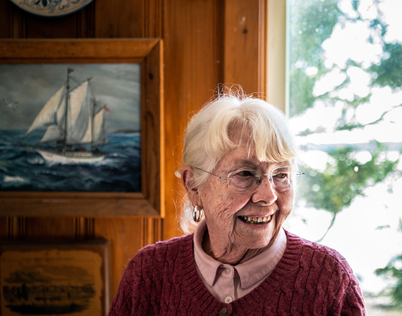 Sally Woolf-Wade stands in front of a maritime painting at her home in New Harbor on Monday, April 27. Woolf-Wade once sailed across the Atlantic on the four-masted Star Clipper. (Bisi Cameron Yee photo)