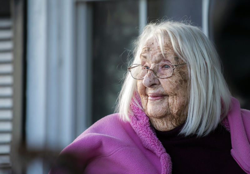 Fran Williamson observes her birthday celebration from her porch in Jefferson on Thursday, April 8. Johnston still lives on her own at 103. (Bisi Cameron Yee photo)