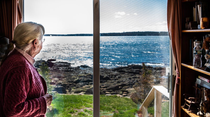 Sally Woolf-Wade looks out on John's Bay from her home in New Harbor on Monday, April 27. Woolf-Wade's father built the home as a summer cottage for family vacations. (Bisi Cameron Yee photo)