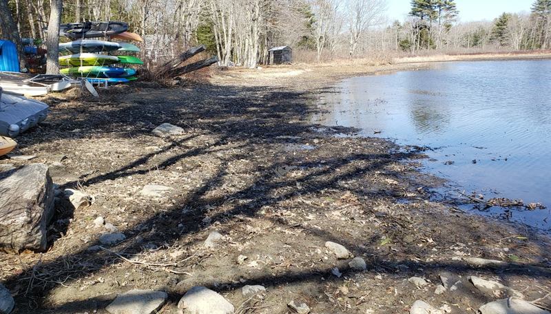 The shore of Damariscotta Lake near Moody's Island on March 23. Lakefront property owner Rebecca Waddell said the water level has come up in the past week from rain, but it is still 1 or 2 feet below its normal level. (Photo courtesy Rebecca Waddell)