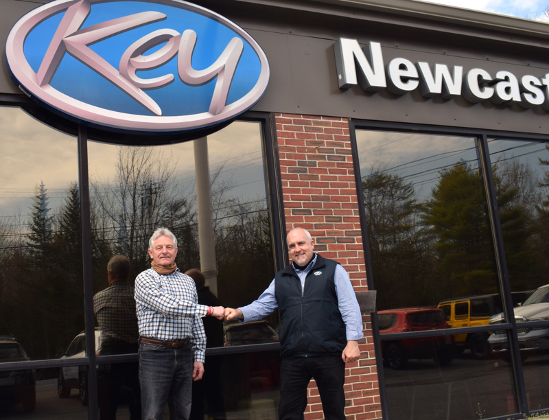 """Randy Miller gives a fist bump to Key Auto Group Regional Vice President Steve """"Hoaty"""" Houghton at Key Chrysler Dodge Jeep Ram of Newcastle on Wednesday, April 21. Miller owned the dealership for nearly 25 years and will stay on as general manager. (Evan Houk photo)"""