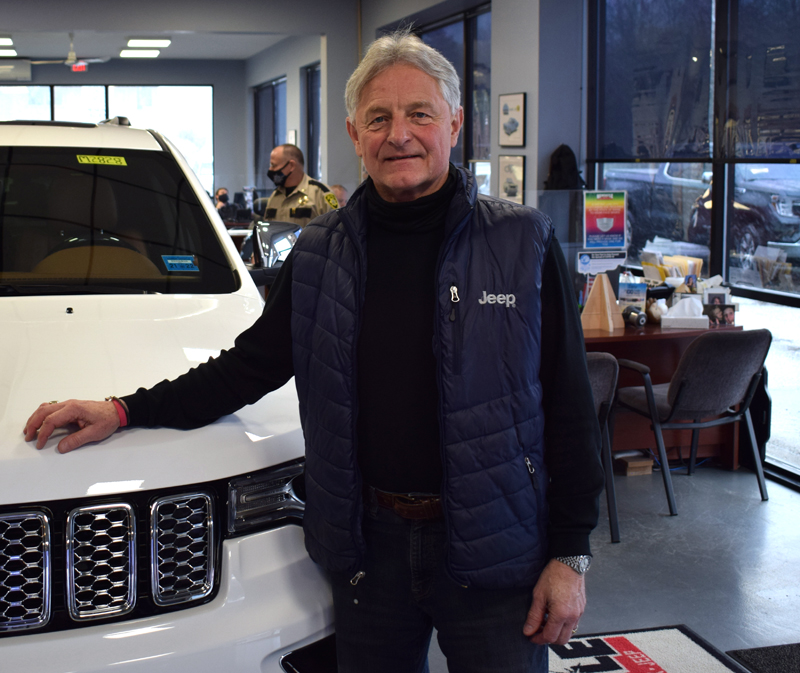 Randy Miller stands in the showroom of Key Chrysler Dodge Jeep Ram of Newcastle on April 16. Miller has sold the dealership to the Key Auto Group, but will stay on as general manager for the foreseeable future. (Evan Houk photo)