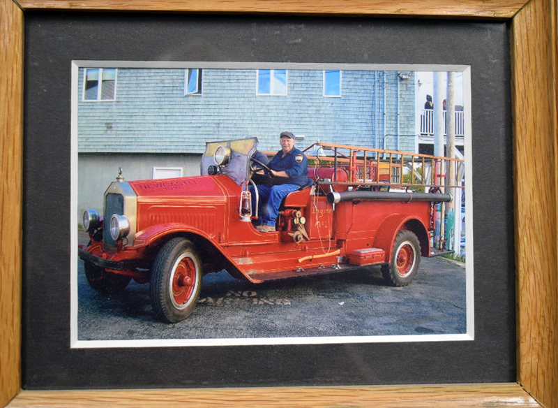 Newcastle Fire Chief Clayton V. Huntley Jr. at the wheel of a 1928 Maxim fire engine. The engine originally belonged to the Taniscot Engine Company and Huntley worked to find it and get it back. (Evan Houk photo)