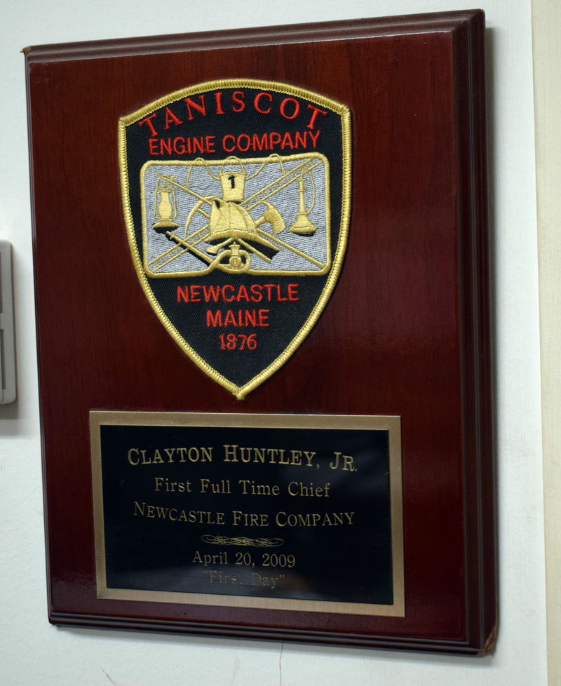 A plague in the fire chief's office at the Clayton V. Huntley Jr. Station in Newcastle commemorates Huntley's installation as the town's first full-time fire chief on April 20, 2009. (Evan Houk photo)