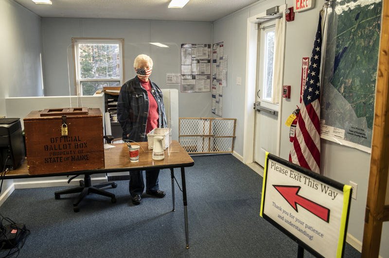 Poll worker Elaine Porter stands by the ballot box during the broadband referendum in Somerville on Tuesday, April 20. The question passed, 49-45. (Bisi Cameron Yee photo)